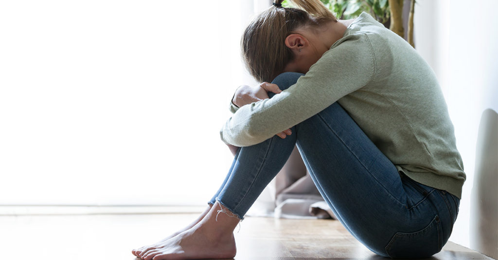 Woman With Head to Knees - Stress And Anxiety - PCS Counseling